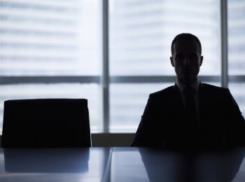 boardroom_job-opening_executive-in-silhouette_empty-chair_new-job-100760295-large